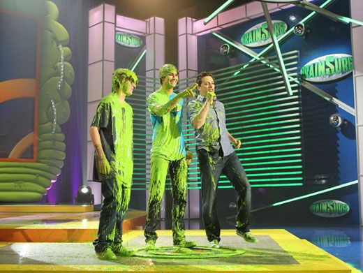 Booger Boogie|Jeff Sutphen just loves to boogie down in booger-y brain goo. Just look at his slime stomp next to James Maslow!