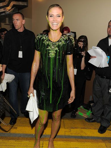 Klum Clean Up|Heidi Klum is ready to towel off after getting slime-faced with globbery goo. Somehow, you still look fashion fab, Heidi.