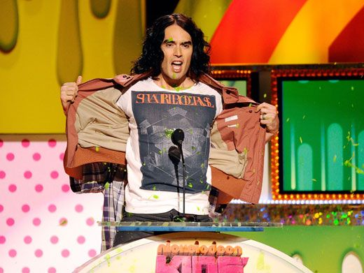 Slime Shield|Russell Brand hid fellow presenter Rico Rodriguez from the slime-ball fight they were having with audience members!