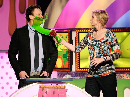 Sipping Slime|Jason Segel got a taste of globbery goo after Jane Lynch slathered him with a slime slurpie.
