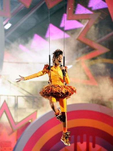 Willow In The Wind|High above the stage, in the midst of a stunning show-stopper of a performance, Willow Smith strikes a graceful pose.