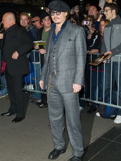 Jetsetter Johnny|Johnny Depp gives a classic suit a bit of attitude with some chains and shades.