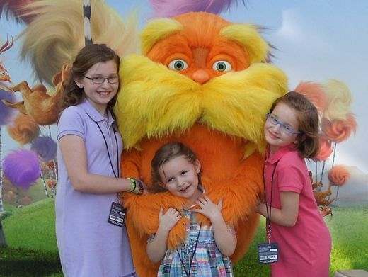 Hug It Out|The girls got their share of Nick-orange by hanging out with this cuddly guy before the show.
