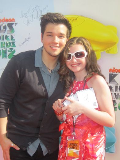 Posing with the Stars|Madison snapped a photo with Nathan Kress after he signed the Nickelodeon wall. That notebook must be full of amazing autographs. So jealous!