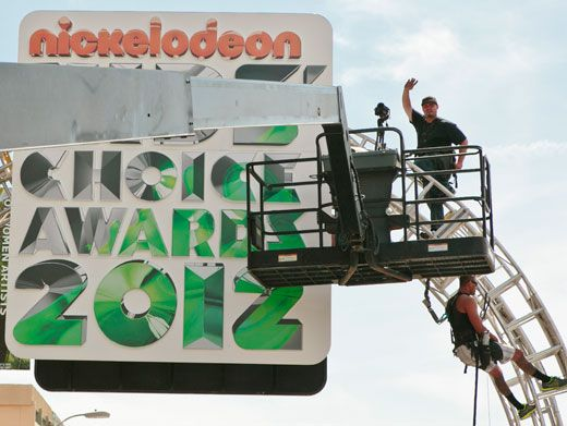 Super Signage|Hello out yonder! This guy clearly isn't afraid of heights...but for the KCAs, we'd do anything too!