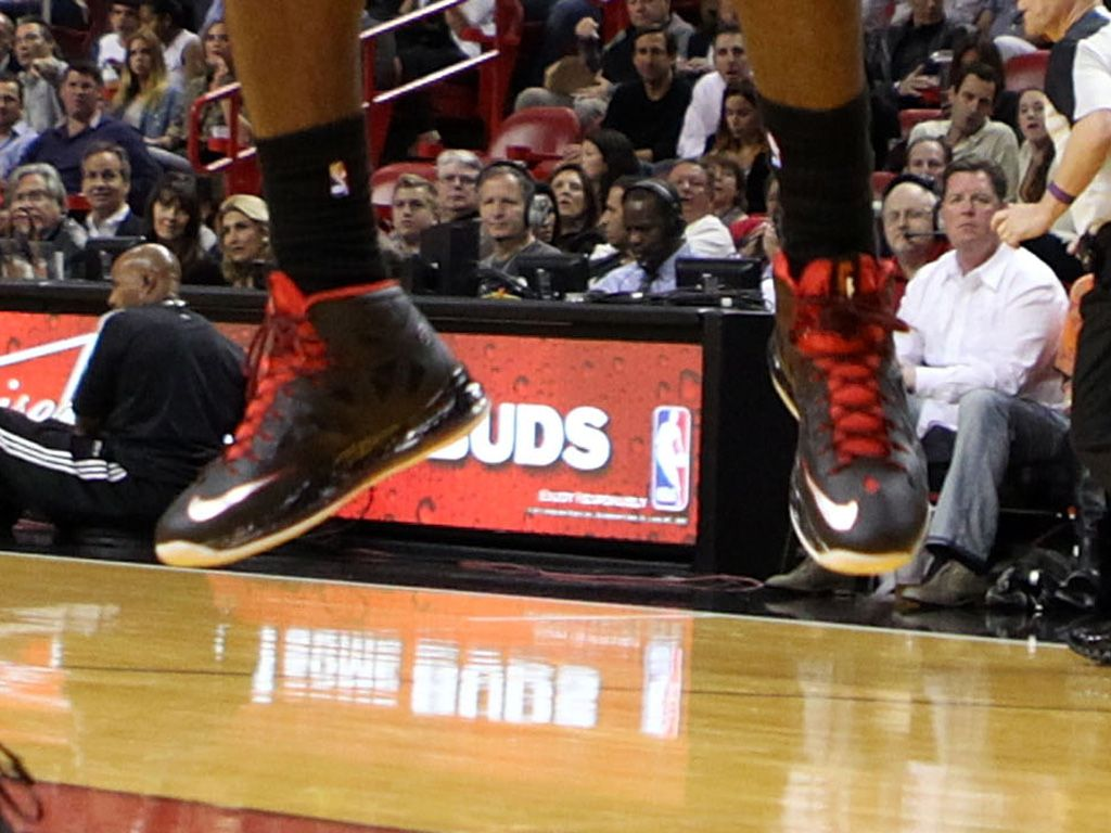Fly Kicks|Who are these black and red sneaks dangling off of...?