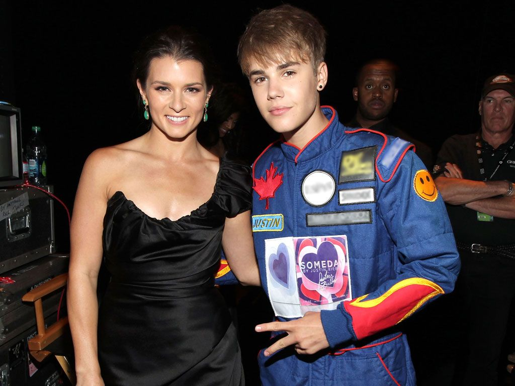Just-in Time|Pro racer Danica Patrick and Justin Bieber are also getting major KCA nom love, but is Justin giving this pro athlete a case Bieber fever? Then again, there's nothing like a guy in uniform!